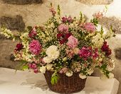 Large Bouquet Of Flowers With A Stone Wall Background