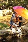 mom with a little boy under an umbrella in the rain