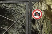 The Ban On Photographing The Object. A Sign At The Entrance Gate Metal. The Caves In The National Pa