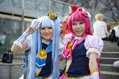 TOKYO, JAPAN - MARCH 23, 2014: Girls dressed as anime characters pose at a cosplay gathering.