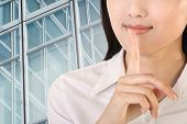 Silent sign with gesture by business woman, closeup image.