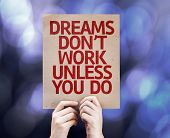 Dreams Don't Work Unless You Do written on colorful background with defocused lights
