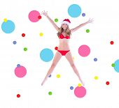 Festive fit blonde in red bikini against dot pattern