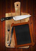 Empty Blackboard On Wooden Cutting Board