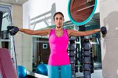 dumbbell lateral shoulder flies fly girl workout exercise at gym
