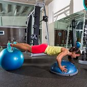 swiss ball bosu push up woman blue fitball workout at gym