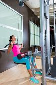 foto of lats  - Cable Lat pulldown machine woman workout at gym exercise - JPG