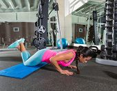 brunette woman at gym knees push up push-up workout exercise