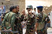 Yemeni military men talk at the security checkpoint, Hadramaut valley, Yemen.