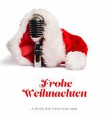 Christmas greeting in german against vintage mic with santa hat