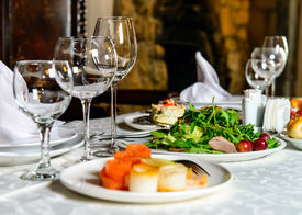 stock photo of banquet  - Served for holiday banquet restaurant table with dishes - JPG