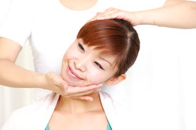 image of chiropractic  - woman getting chiropractic in the chiropractic office - JPG