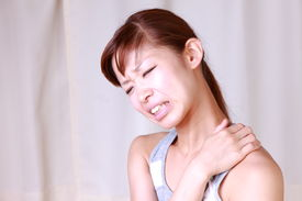 image of stiff  - young Japanese woman suffers from stiff neck - JPG
