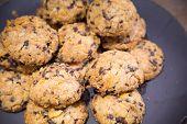stock photo of baked raisin cookies  - Cookies with raisins on wooden table - JPG