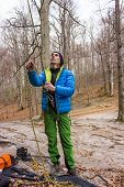 image of mountain-climber  - The young man in the mountains insures climber - JPG