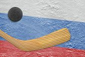 stock photo of hockey arena  - Hockey puck hockey stick and the image of the Russian flag on the ice - JPG