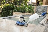 image of stone floor  - Close up blue polishing machine on the stone floor - JPG