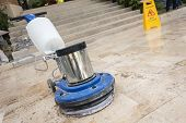 picture of stone floor  - Close up blue polishing machine on the stone floor - JPG