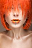 stock photo of wig  - Beautiful girl in an orange wig cosplay style with bright creative lips - JPG