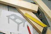 image of draft  - wooden planks with tools and draft on tablesaw - JPG