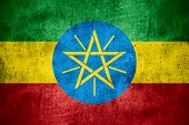 picture of ethiopia  - flag of Ethiopia or Ethiopian banner on rough pattern texture background - JPG