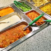 pic of buffet catering  - Catering buffet with a variety of vegetarian food in metal containers - JPG