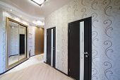 pic of premises  - Hallway with two doors and sliding mirror wardrobe - JPG