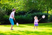 foto of little school girl  - Active children playing badminton - JPG
