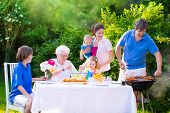 stock photo of mother-in-love  - Grill barbecue backyard party - JPG