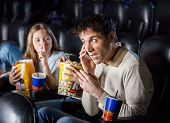 pic of shh  - Annoyed daughter giving shh expression to father using mobilephone in cinema theater - JPG