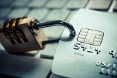 foto of theft  - a credit card with security lock on a computer keyboard - JPG