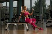 image of bicep  - Mature Woman Working Out Biceps In Fitness Center  - JPG