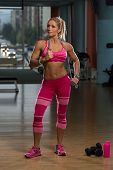 pic of jump rope  - Middle Age Womane Playing Around With Jumping Rope As Part Of Bodybuilding Training - JPG