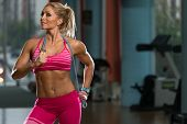 foto of jump rope  - Middle Age Womane Playing Around With Jumping Rope As Part Of Bodybuilding Training - JPG