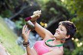 picture of tibetan  - Hands of a woman playing tibetan singing bowl in nature  - JPG