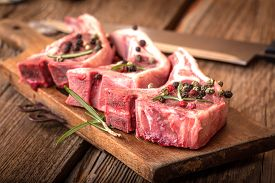 stock photo of lamb shanks  - Raw lamb chop ready for frying - JPG