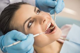 pic of hospital patient  - Dentist examining a patient - JPG