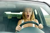 Scared Woman Shouts Driving The Car
