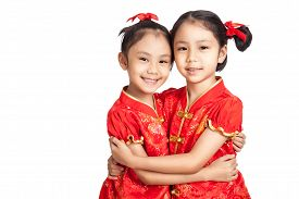 pic of identical twin girls  - Asian twins girls in chinese cheongsam dress isolated on white background - JPG