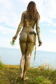 stock photo of tarzan  - Beautiful naked girl in a loincloth totally wild - JPG
