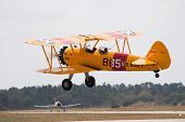 PALM COAST, FLORIDA - MARCH 27: A Bi-plane takes off at the Wings Over Flagler Air Show at the Flagl