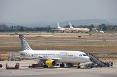 VALENCIA, SPAIN - JUNE 24: Vueling Airlines will start connections on July 5 in Barcelona, which will increase their passengers by 250,000. A Vueling aircraft at the Valencia Airport on June 24, 2010.