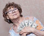senior happy woman with money