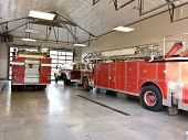 picture of firehouse  - fire trucks in garage at the ready for a fire - JPG