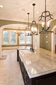 extravagant kitchen looking into diningroom with view