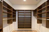 large walk in closet with modular shelves