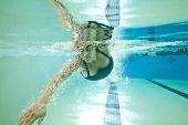 underwater shot of female swimmer doing freestyle stroke