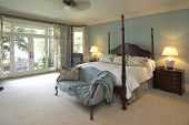 beautiful classical style bedroom with four poster bed