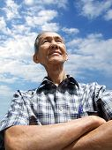 pic of older men  - Isolated chinese senior man with confident and cloudy blue sky - JPG