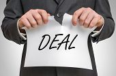 Businessman Tearing Paper With Deal Word poster